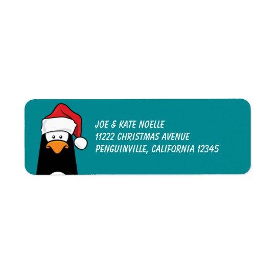 Etiqueta Pingüino del navidad en un gorra de Santa