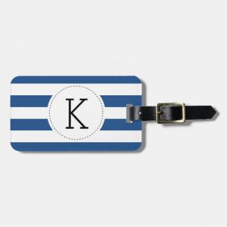 Etiqueta rayada del equipaje del monograma de los
