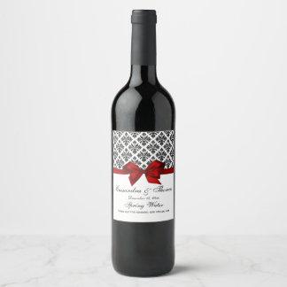 Etiqueta roja de la botella de vino del damasco