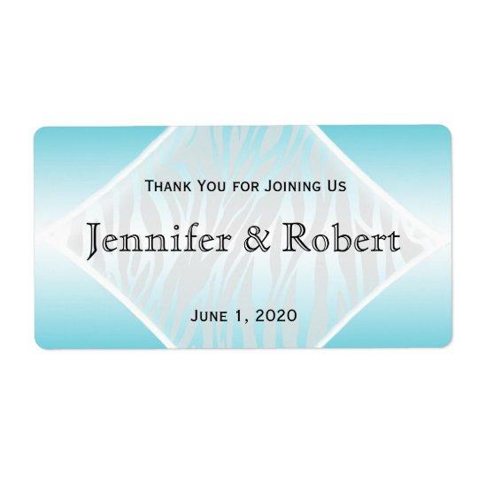 Etiqueta verde azulada y blanca de la botella de etiquetas de envío