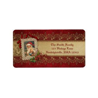 Etiqueta Vintage Santa con el cordón del Poinsettia y del