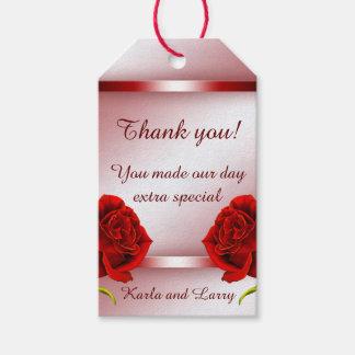 Etiquetas color de rosa de mármol rojas del regalo