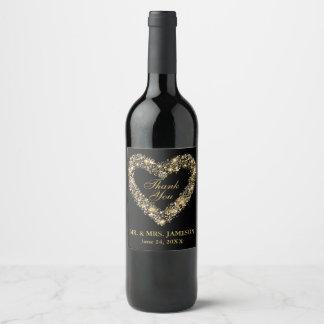 Etiquetas del vino del corazón del oro del boda y