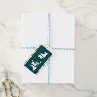 Etiquetas Para Regalos Felices Navidad del vintage con el fondo azul