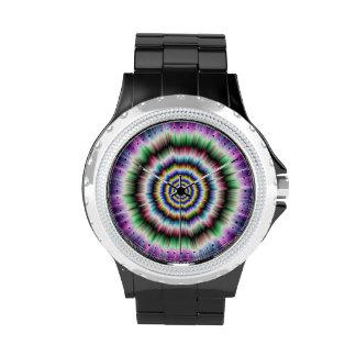 Explosión en el reloj verde y azul violeta