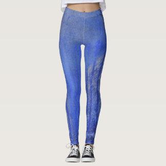 Extracto azul de la pintura con los rasguños y los leggings