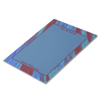 Extracto del chasquido del color de azul rojo bloc de notas