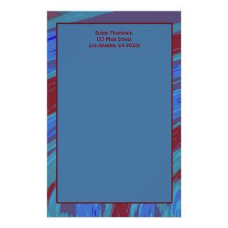 Extracto del chasquido del color de azul rojo papelería