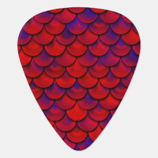 Falln escalas rojas y de la púrpura uñeta de guitarra