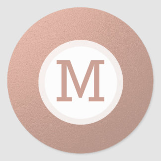 Falso sello color de rosa de la inicial del