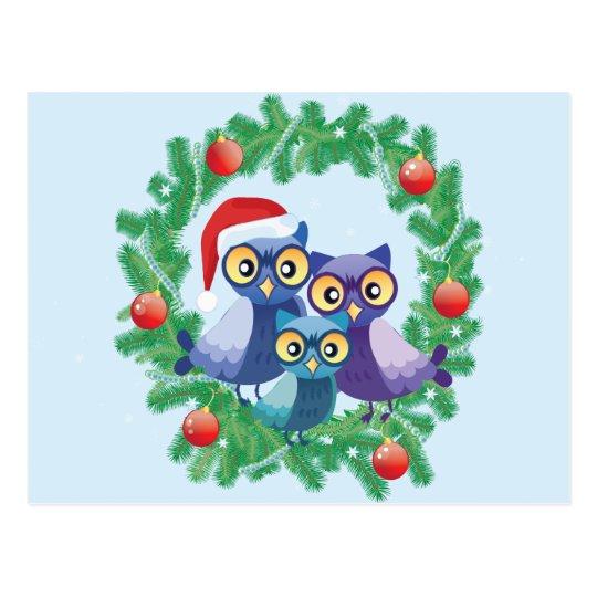Familia de los búhos del navidad postal
