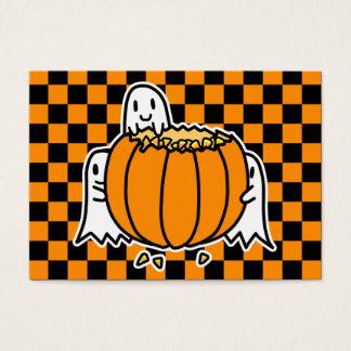 Fantasmas y tarjeta de Halloween de la calabaza