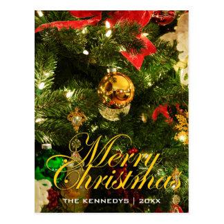 Felices decoraciones del árbol de navidad postal