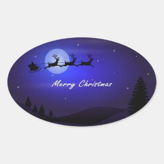 Felices Navidad de la luna del trineo de Santa Pegatina Ovalada