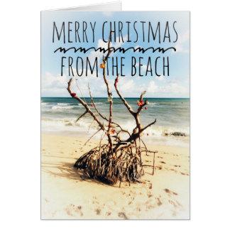 Felices Navidad de la tarjeta de la playa