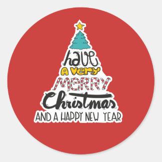 Felices Navidad y pegatina del Año Nuevo