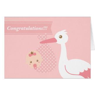 Felicite a los nuevos padres - cigüeña con la niña