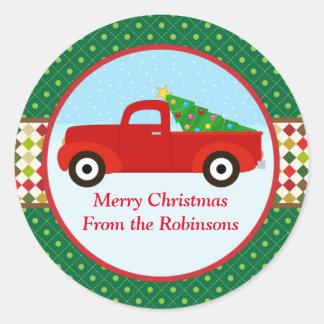 Feliz árbol de navidad en un pegatina del camión