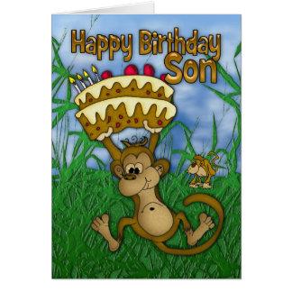Feliz cumpleaños del hijo con la torta de la tarjeta