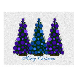 Feliz postal azul y púrpura del árbol de navidad
