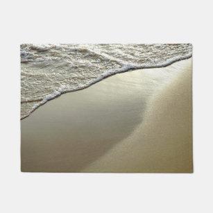 Felpudo el doormat de la playa