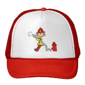 Figura bombero del palillo con la manguera gorra