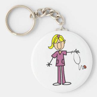 Figura femenina rubia enfermera del palillo llavero redondo tipo chapa