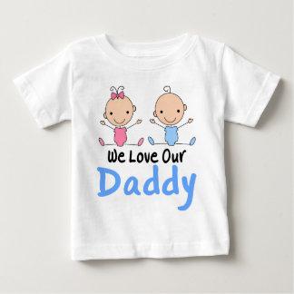 Figura gemela bebés del palillo del muchacho y del camiseta de bebé