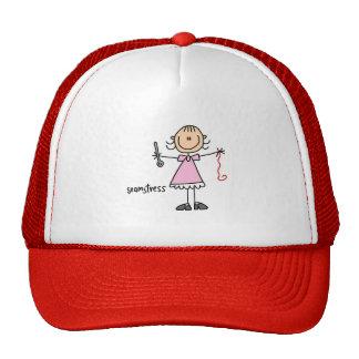 Figura gorra del palillo de la costurera
