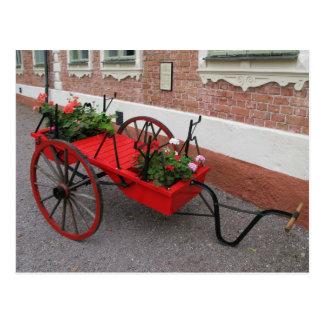 Flor-Carro rojo en la postal