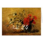 florero con los claveles rojos y blancos tarjetas