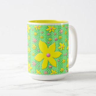 Flores amarillas y rosadas de la taza - en verde -