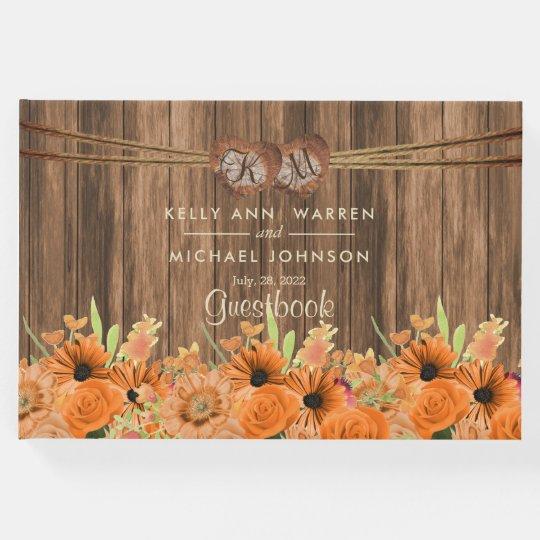 Flores anaranjadas hermosas en la madera - libro de visitas