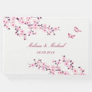 Flores de cerezo que casan el libro de visitas