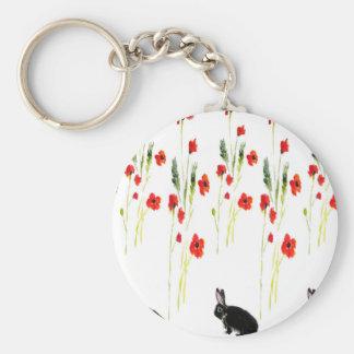 Flores de la amapola y un conejo de conejito lindo llavero redondo tipo chapa