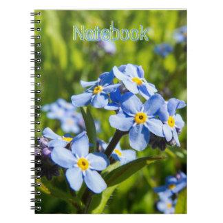 Flores del azul de la primavera cuaderno