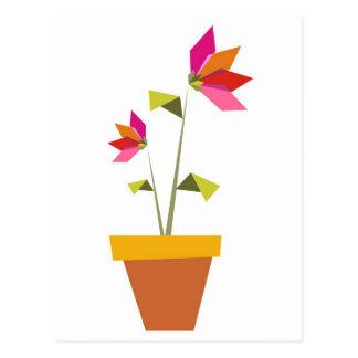 flores del origami en un pote postal