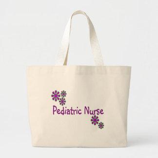 Flores pediátricas de la púrpura de la enfermera bolsa tela grande