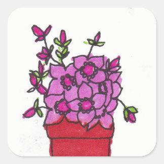 Flores rosadas en pegatina de pote rojo
