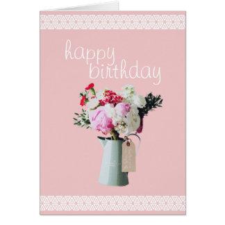 Flores rosadas en una tarjeta de cumpleaños
