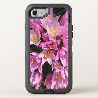 Flores rosadas y amarillas tropicales funda OtterBox defender para iPhone 7