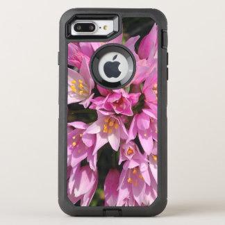 Flores rosadas y amarillas tropicales funda OtterBox defender para iPhone 7 plus