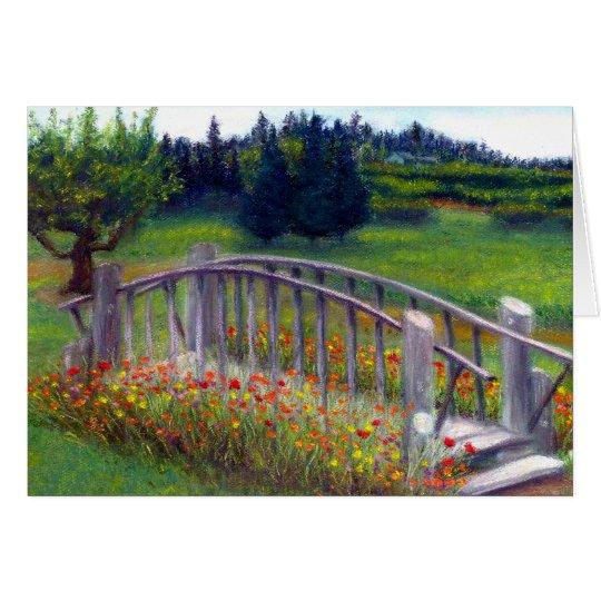 Flores y pasarela en tarjeta en blanco del carril