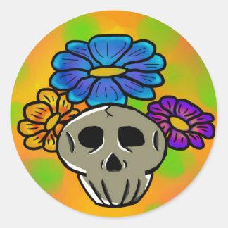 Flores y pegatina de los cráneos