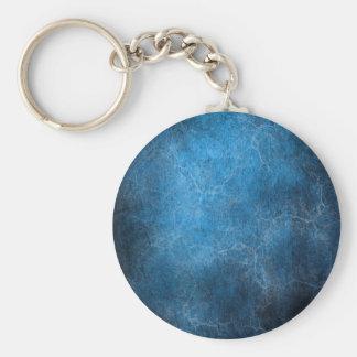 Fondo azul y negro llavero redondo tipo chapa