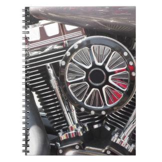 Fondo cromado motocicleta del detalle del motor cuaderno