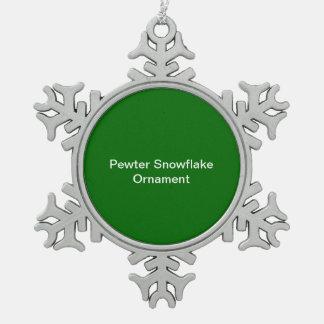 Fondo del verde del ornamento del copo de nieve adorno de peltre en forma de copo de nieve