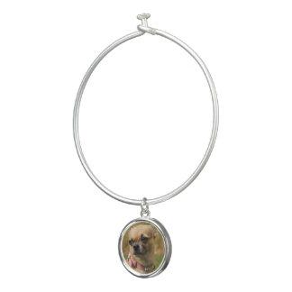 Foto de la pulsera del brazalete del perrito el |