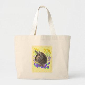 Foto y flores lindas del conejo bolsas