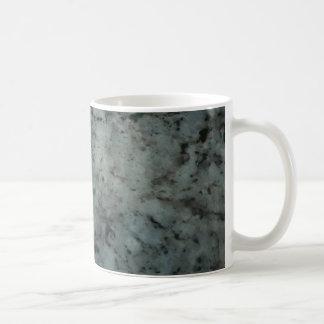 Fotografía azul de la textura del granito taza básica blanca